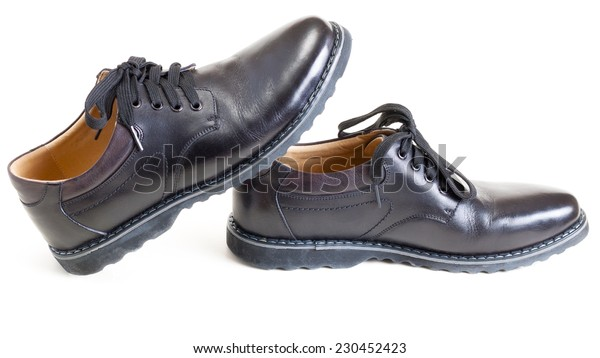 couple of men's black leather shoes