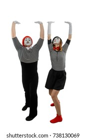 Couple of mimes in action. Man and woman performing a pantomime, pretending like they try to keep something heavy. Acting skills concept.