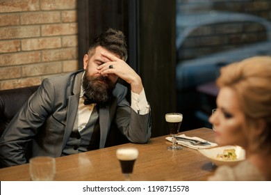 couple with misunderstanding at restaurant. Valentines day with woman and man. Dislike makes conflict and divorce. Business meeting of man and woman. Bad date of couple, break up relations and love