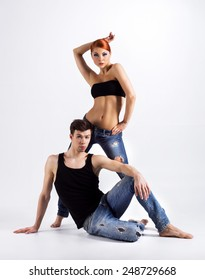 Couple of modern ballet dancers in jeans