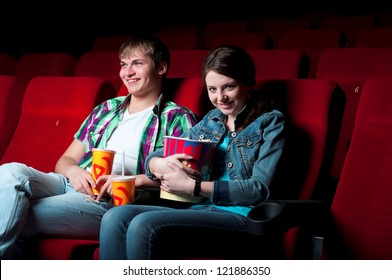 couple in a movie theater, watching a movie
