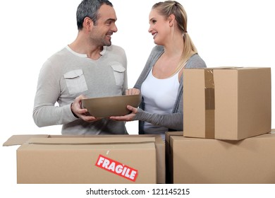Couple moving in to new home