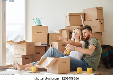 Couple moving new home. Happy married people buy new apartment