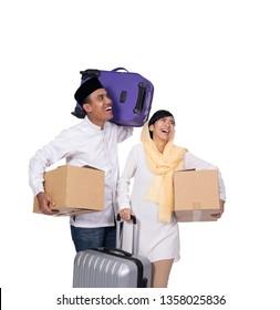 couple muslim people going for eid mubarak travel holiday. mudik lebaran concept