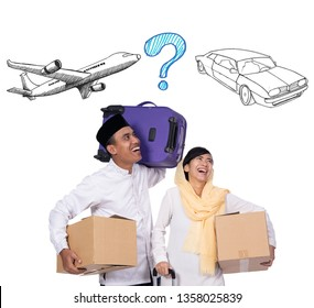 couple muslim people going for eid mubarak travel holiday. mudik lebaran concept by place or car