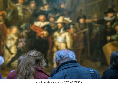Couple At The Nachtwacht Painting At The Rijksmuseum Amsterdam The Netherlands 2018