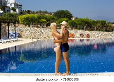 Couple near a swimming pool in Cyprus