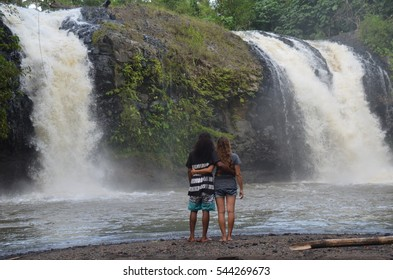 couple near waterfall, Galela, Halmahera Utara, East Indonesia