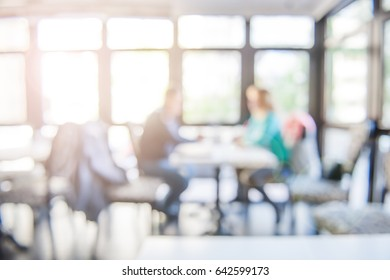 The couple is in negotiations in modern office -  job interview room.  Two businessman talking in modern interior. Blur abstract background indoor. New project. Working in team.