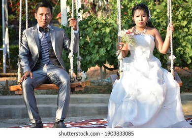 A couple of newlyweds on the swings