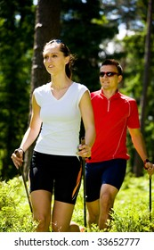 a couple nordic walking in the forest