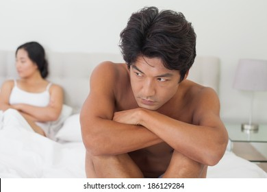 Couple not talking after argument in bed at home in bedroom
