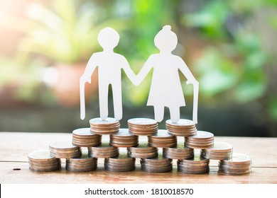 couple older model standing on money coins saving for concept investment mutual fund finance and pension retirement