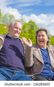 A couple of older people with a big smile is proof that love can last for a long time.