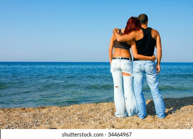 The couple is on the beach