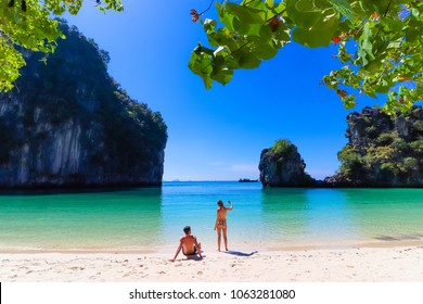"couple on the beach with crystal clear water at ""Hong Island"" Paradise Tropical Beach Island in Krabi, Thailand"