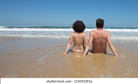 couple on the beach doing nudism vacation naturism holidays