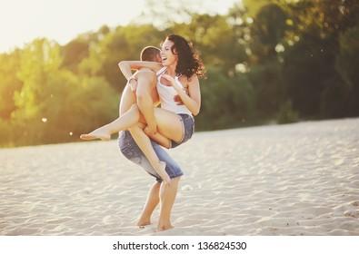Couple on the beach having fun, going crazy