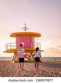 couple on the beach at Miami beach, life guard hut Miami beach Florida