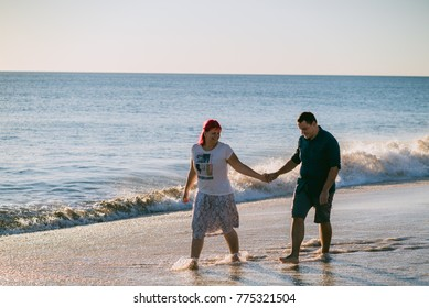 Couple on a beach in Portugal at sunset