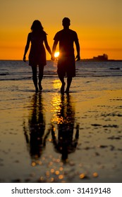 A Couple on the Beach at Sunset