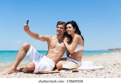 couple on beach taking self photo picture with cell phone, travel woman and man happy smiling in camera, summer holidays vacation