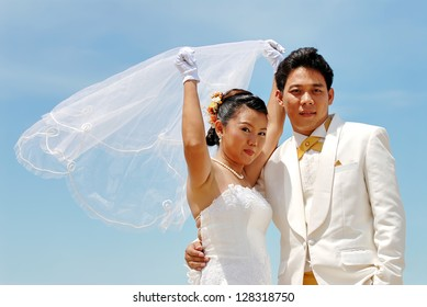 Couple on the beach in wedding dress. Bride and Groom