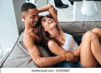 Couple on bed. African man. so happy couple