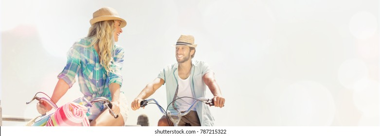Couple on bike ride by the beach