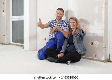 A Couple on construction site in new building