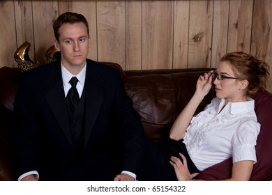Couple on a couch, she is flirting