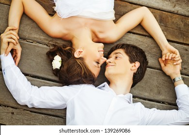 couple on the floor (soft focus on the eyes of bride)