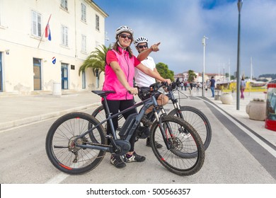 Couple on holiday with the bikes