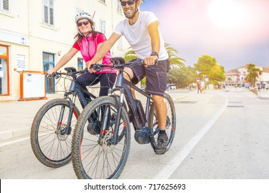Couple on holiday with electric bicycles