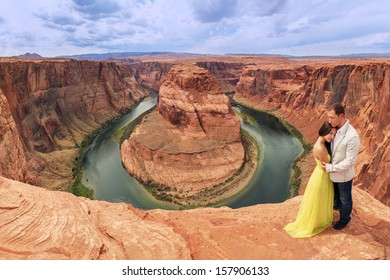 A couple on a honeymoon trip at  Horseshoe Bend, Page, Arizona