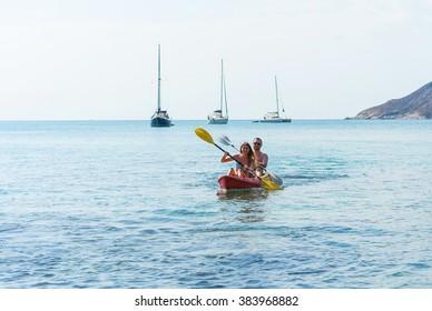 Couple on kayak on the beautiful bay