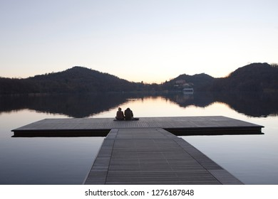 couple on the lake looking sunshine
