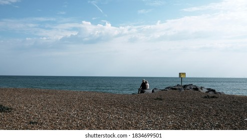 Couple on Lancing beach Sussex