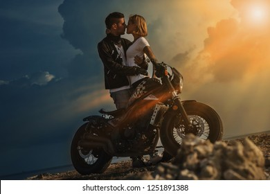 Couple on a motorbike at sunset