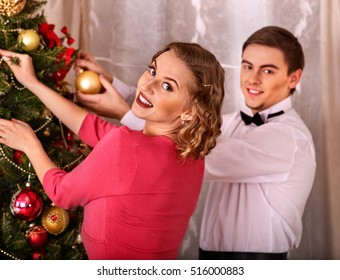 couple on party near christmas tree black and white retro young people decoration christmas - Black People Christmas