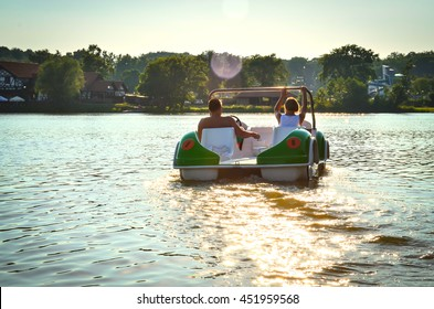 The couple on the pedal boat on the lake Jeziorak in Poland