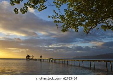 Couple on pontoon at sunset