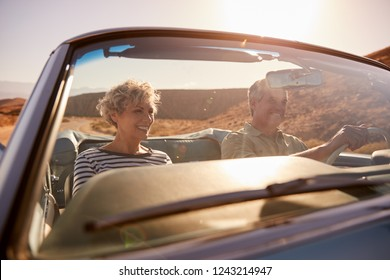 Couple on road trip, seen through car windscreen, close up