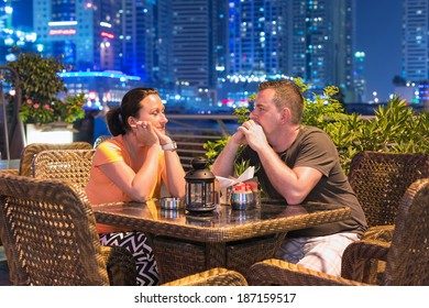 Couple on romantic dinner in outdoor city scenery