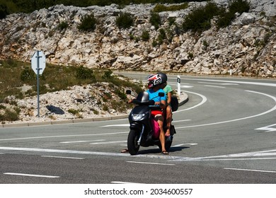couple on a scooter stand on the road background of mountains. High quality photo