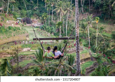 Couple on a swing with a view of rice terraces in Ubud, Bali