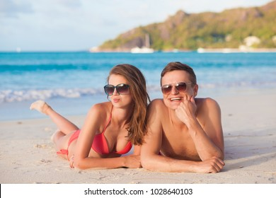 Couple on a tropical beach at Mahe island, Seychelles