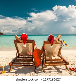 Couple on a tropical beach in Maldives at christmas