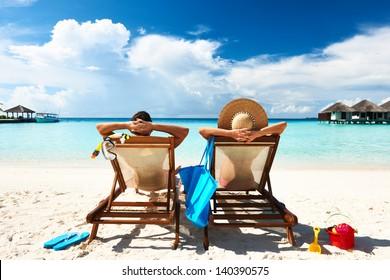Couple on a tropical beach at Maldives