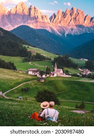 couple on vacation in the Italian Dolomites, Santa Maddalena Santa Magdalena village with magical Dolomites mountains in autumn, Val di Funes valley, Trentino Alto Adige region, South Tyrol, Italy